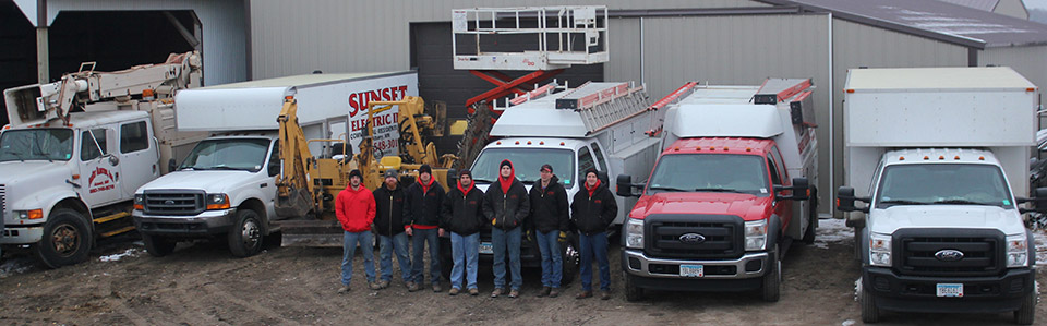 Group Photo of Sunset Electric Team Members and Service Trucks